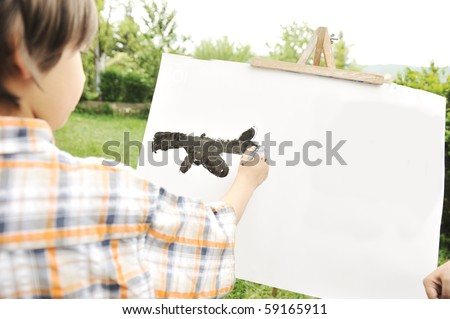 Kid drawing and painting outdoor - stock photo