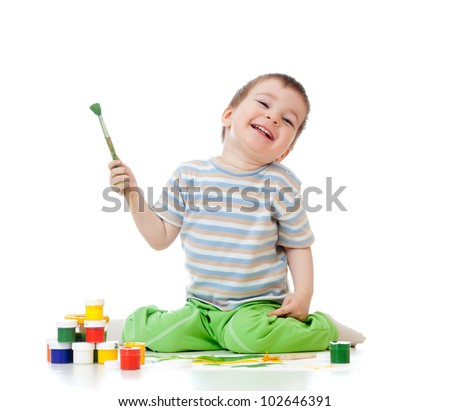 kid drawing with watercolor paints - stock photo