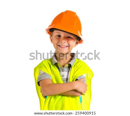 Kid dressed like worker with his arms crossed   - stock photo