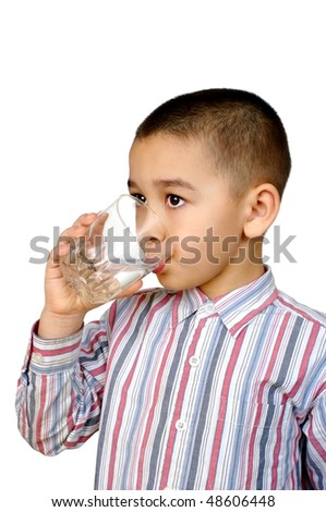 Kid drinking glass of water, isolated on white background - stock photo