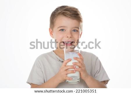 kid drinks a glass of milk - stock photo