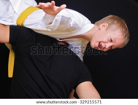 Kid during karate, judo training. Martial arts.Sport, active lifestyle concept