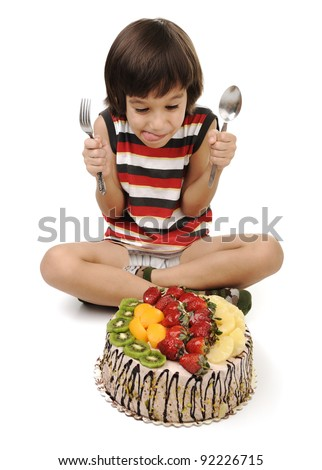 Kid eating cake - stock photo