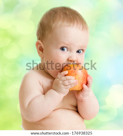 Kid eating fruit, healthy food - stock photo