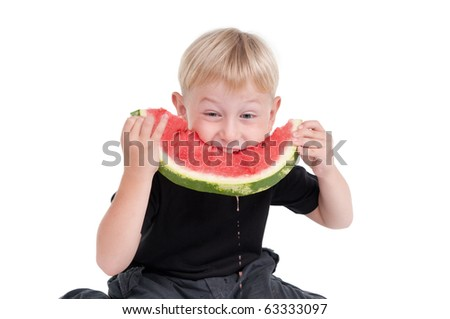 Kid eating hungrily a slice of watermelon - stock photo