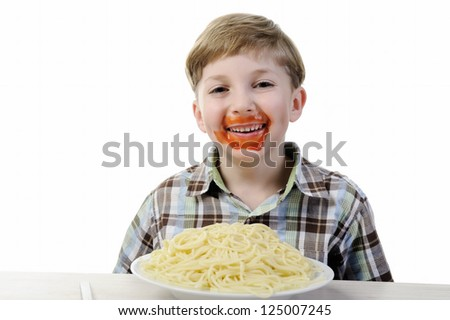 Kid eating spaghetti - stock photo