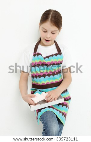 Kid eating sweet paste from town Kolomna, Russia - stock photo