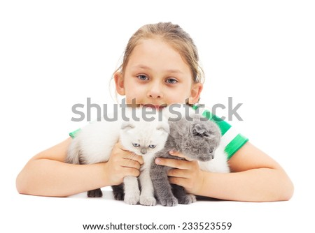 kid embraces three British lop-eared kitten on a white background isolated - stock photo