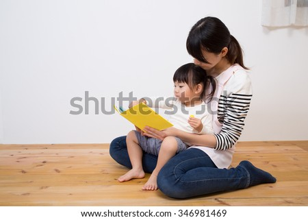 kid enjoy with story telling - stock photo