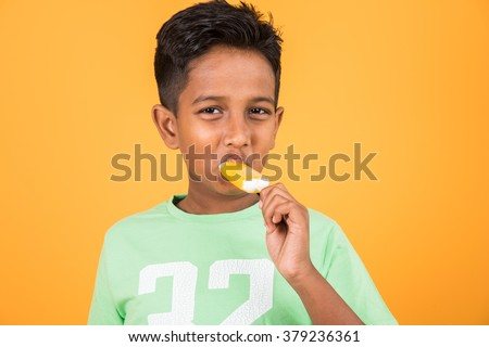 kid enjoying ice cream, indian boy and ice cream, ice cream and india, 10 year boy eating ice cream, isolated on colourful background