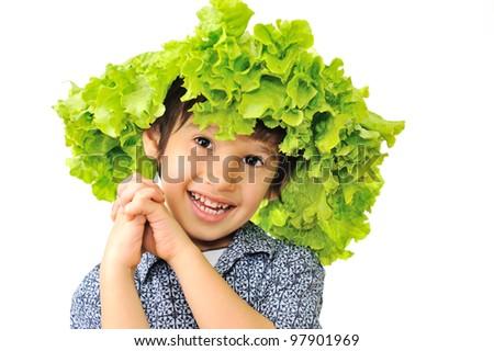 Kid enjoying salad on his head - stock photo