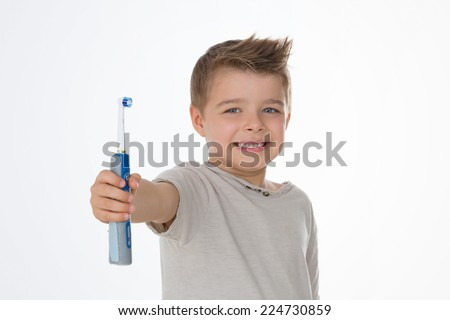 kid exhibits his brand new electric toothbrush