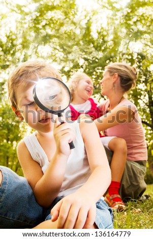 Kid exploring - stock photo