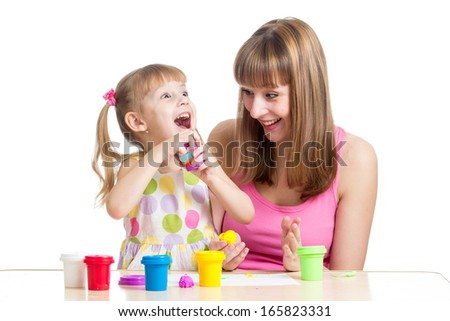 kid girl and mother playing colorful clay toy - stock photo