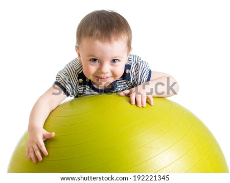 kid girl doing fitness exercise with fitness ball - stock photo