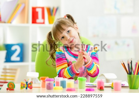 kid girl drawing and making by hands - stock photo