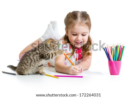 kid girl drawing with pencils and playing with kitten - stock photo