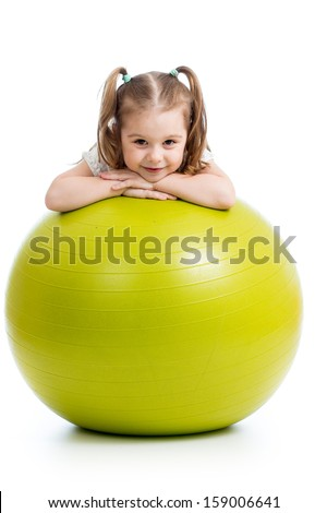 Kid girl having fun with  gymnastic ball isolated - stock photo