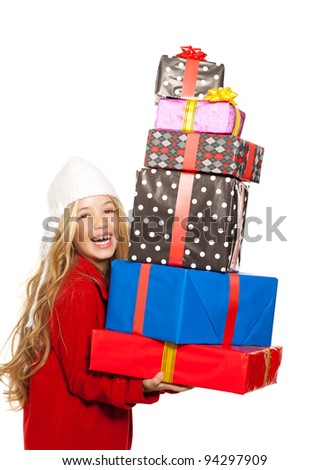 kid girl holding many gifts stacked on her hand isolated on white - stock photo
