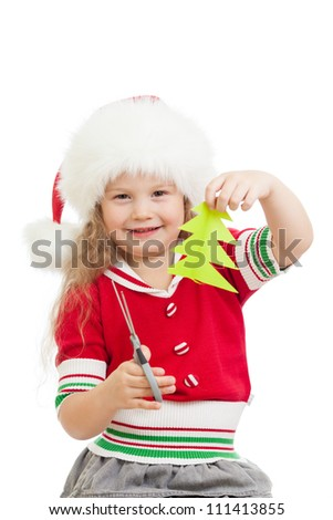 kid girl in Santa Claus hat cutting christmas tree from paper - stock photo