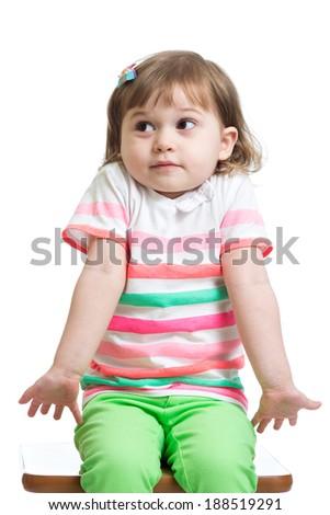 kid girl looks puzzled, isolated - stock photo