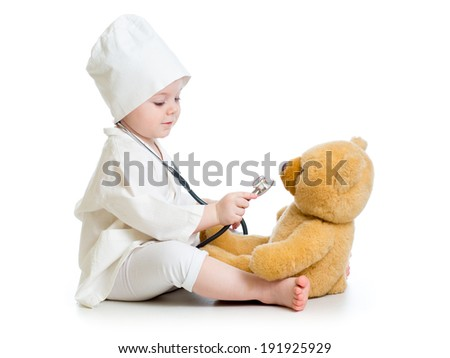 kid girl playing doctor with toy - stock photo