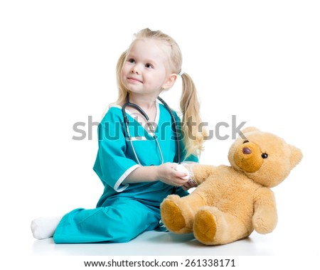 kid girl playing doctor with toy isolated - stock photo