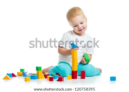 kid girl playing toy blocks  isolated on white background