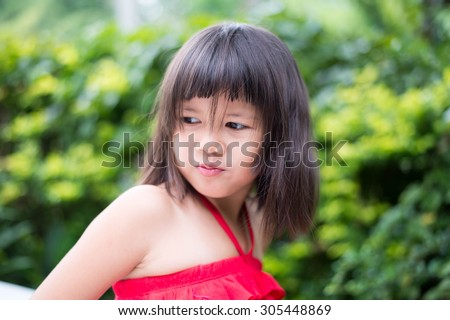 kid, girl, pretty, childhood, asian, happy, asian, little,beautiful, portrait, red, thoughtful, musing, pensive, dress, calm, quiet, cute, daydream, reverie, young,contemplative,reflective, - stock photo