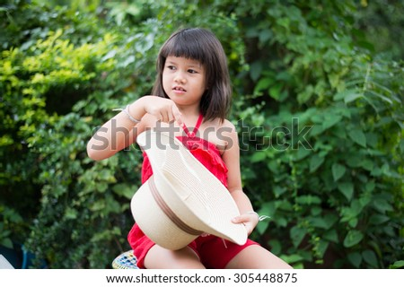 kid, girl, pretty, childhood, asian, happy, asian, little,beautiful, portrait, red, thoughtful, musing, pensive, dress, calm, quiet, cute, daydream, reverie,  - stock photo