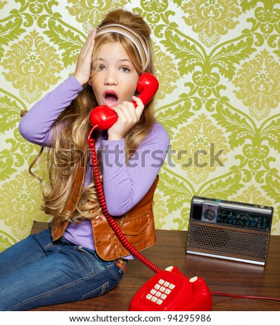kid girl retro hip vintage talking busybody with red telephone - stock photo