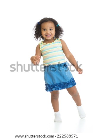 Kid girl standing or dancing full length isolated on white