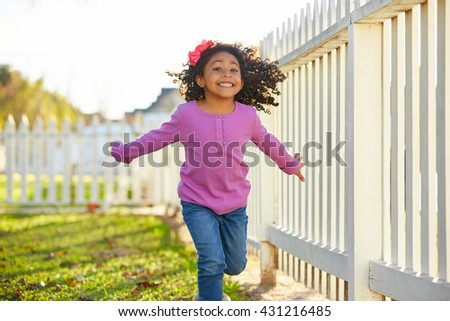 kid girl toddler playing running in park outdoor latin ethnicity - stock photo