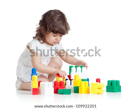 kid girl with construction set toy over white background