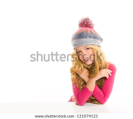 Kid girl with winter wool cap happy smiling on white background - stock photo
