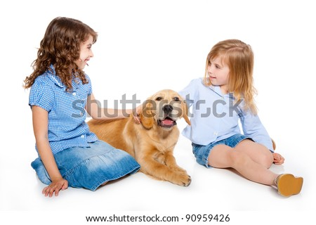 kid girls with Golden retriever puppy isolated on white background
