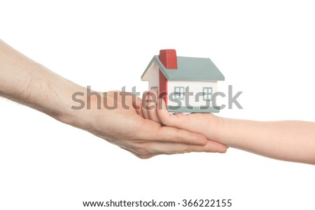 kid give model of home to adult