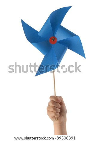 Kid hand holding a blue pinwheel close up isolated on white background.  Included clipping path, so you can easily cut it out and place over the top of a design. - stock photo