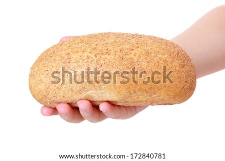 kid hand holding bread - stock photo