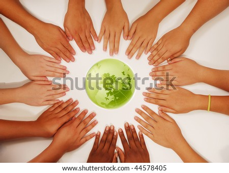 kid hands and the earth globe - stock photo