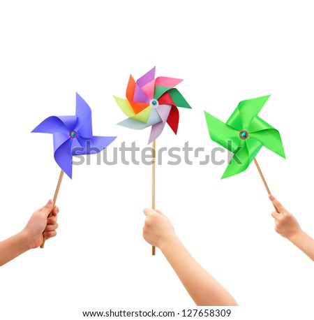 Kid hands holding colorful pinwheel close up isolated on white background. - stock photo