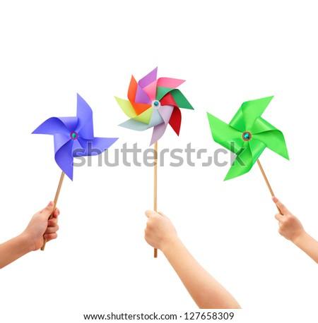 Kid hands holding colorful pinwheel close up isolated on white background. - stock photo