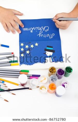 Kid hands making christmas postcard - stock photo