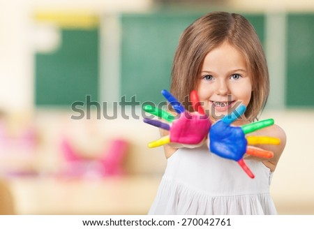 Kid. Happy looking kid playing with paints in his fingers. - stock photo
