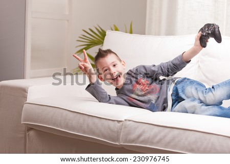 Kid having fun with video games in a brighly lit living room