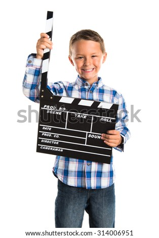 Kid holding a clapperboard  - stock photo