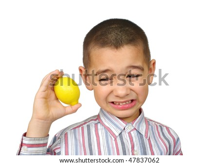 Kid holding a lemon and making a funny face, six years old - stock photo