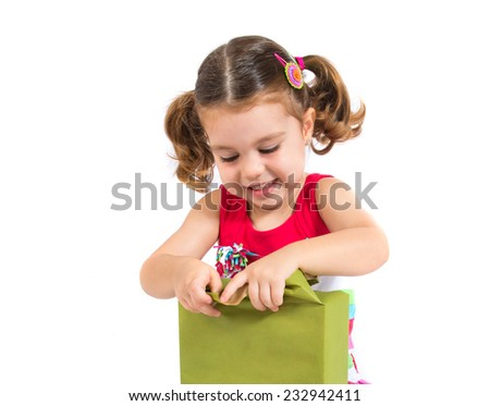Kid holding a present over white background - stock photo