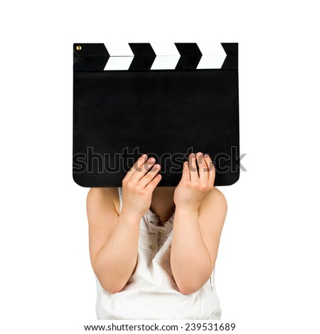 Kid holding blank clapper board isolated on a white background - stock photo