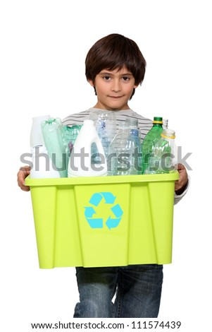 kid holding recycling tub full of empty plastic bottles - stock photo